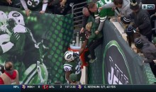 New York Jets Fan Lowers His Child Over Wall To Grab Bilal Powell's TD Ball (VIDEO)