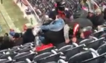 Browns Fan Falls Down Multiple Seats Onto A Family After Having Snowball Fight With Bears Fans (VIDEO)