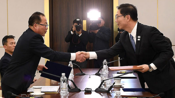 PANMUNJOM, SOUTH KOREA - JANUARY 17: In this handout image provided by the South Korean Unification Ministry, South Korean Vice Unification Minister Chun Hae-Sung, (R) shakes hands with the head of North Korean delegation Jon Jong-Su (L) after their meeting on January 17, 2018 in Panmunjom, South Korea. South and North Korea agreed to field a joint women's ice hockey team for the PyeongChang Winter Olympics and march together under a 'unified Korea' flag at the opening ceremony. (Photo by South Korean Unification Ministry via Getty Images)