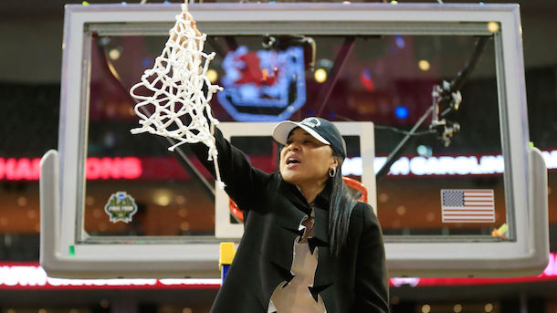 DALLAS, TX - APRIL 02: Head coach Dawn Staley of the South Carolina Gamecocks cuts down the net after winning the 2017 NCAA championship.  (Image via Getty)