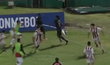 Ecuadorian Soccer Player Uses Corner Flag as a Weapon to Fend Off Attackers During Brawl (VIDEO)