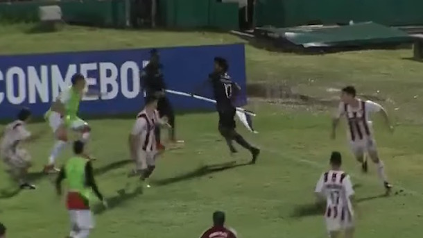 Ecuadorian Soccer Player Uses Corner Flag as Weapon to Defend Himself Against Opposing Players During South American Soccer Brawl