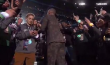 Kid In Crowd Ignores Justin Timberlake's Performance To Search The Web (VIDEO)