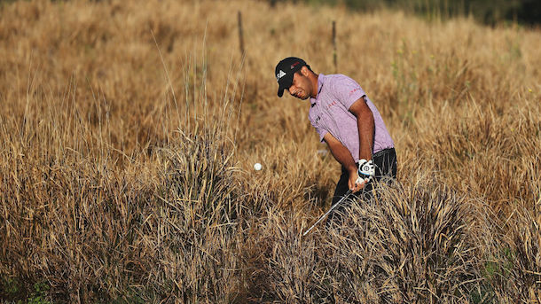 NEW DELHI, INDIA - MARCH 08:  Shubhankar Sharma of India plays out of the rough on the 11th hole during day one of the Hero Indian Open at Dlf Golf and Country Club on March 8, 2018 in New Delhi, India.  (Photo by Matthew Lewis/Getty Images)