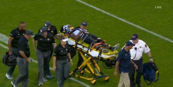 UCF's Aaron Robinson taken off on a stretcher after opening kickoff