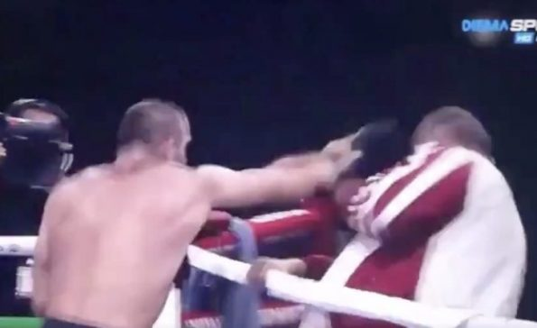 Boxer heel-turns and bizarrely attacks his own poor coach