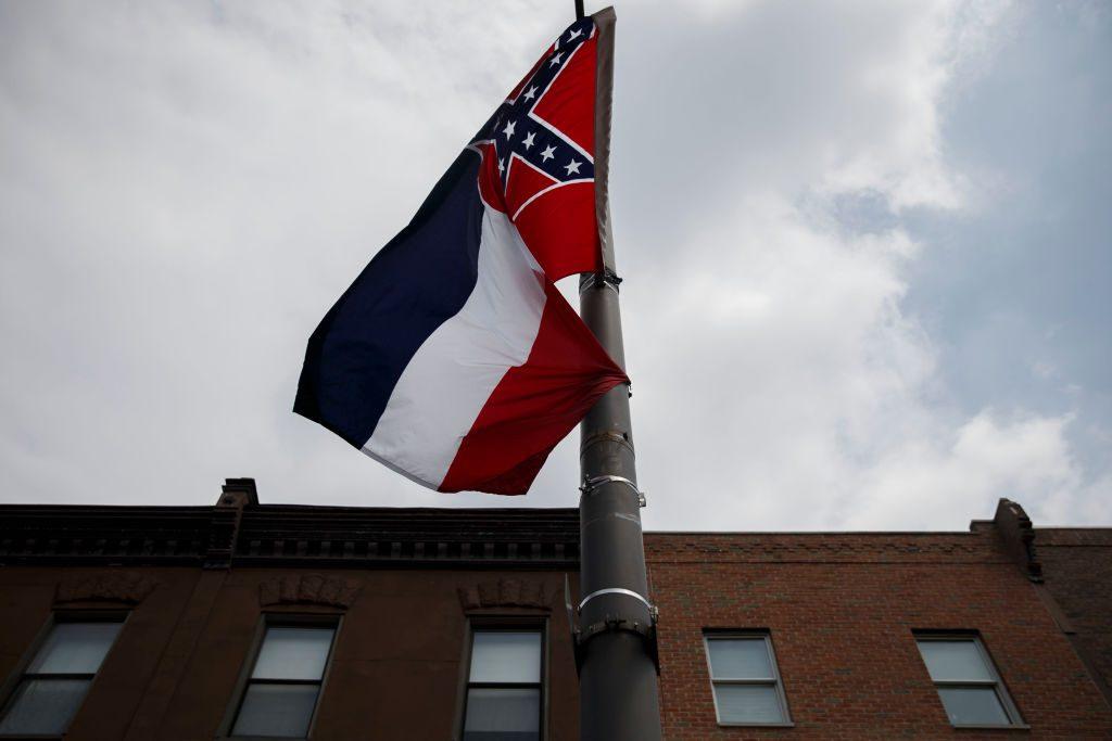 SEC's Greg Sankey stands against Mississippi flag; Mississippi State, Ole Miss react